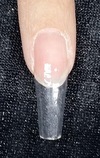 Nagel über Schablone verlängern